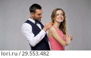 happy man giving diamond necklace to woman. Стоковое видео, видеограф Syda Productions / Фотобанк Лори