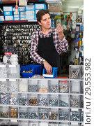 Купить «worker in hardware store trading goods for water tap in uniform», фото № 29553982, снято 4 мая 2017 г. (c) Яков Филимонов / Фотобанк Лори