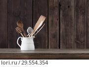 Купить «kitchenware on old wooden background», фото № 29554354, снято 27 ноября 2018 г. (c) Майя Крученкова / Фотобанк Лори