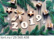 Купить «New Year 2019 festive background with 2019 figures,Christmas toys, fir tree branches and snowflakes -2019 festive design», фото № 29560438, снято 29 ноября 2016 г. (c) Зезелина Марина / Фотобанк Лори
