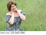 Купить «Portrait of beautiful woman in the grass on a summer day», фото № 29560946, снято 19 июня 2017 г. (c) Володина Ольга / Фотобанк Лори