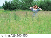 Купить «Beautiful smiling middle-aged woman in nature in summer», фото № 29560950, снято 19 июня 2017 г. (c) Володина Ольга / Фотобанк Лори