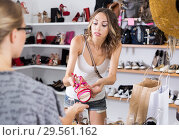 Купить «Women unpleasantly surprised by prices for shoes», фото № 29561162, снято 17 августа 2017 г. (c) Яков Филимонов / Фотобанк Лори