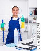 Купить «Young cleaner woman in protective uniform at office», фото № 29561178, снято 19 декабря 2018 г. (c) Яков Филимонов / Фотобанк Лори