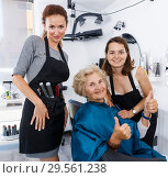 Купить «Hairstylists presenting result of styling to female client», фото № 29561238, снято 26 июня 2018 г. (c) Яков Филимонов / Фотобанк Лори