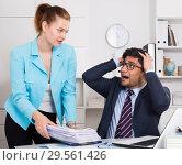 Купить «Overworked businessman with sheaf of papers», фото № 29561426, снято 1 июня 2017 г. (c) Яков Филимонов / Фотобанк Лори