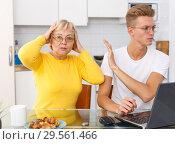 Купить «Sad son and unhappy mother quarrelling», фото № 29561466, снято 25 октября 2018 г. (c) Яков Филимонов / Фотобанк Лори