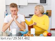 Купить «Sad son and unhappy mother quarrelling», фото № 29561482, снято 25 октября 2018 г. (c) Яков Филимонов / Фотобанк Лори