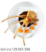 Купить «Top view of baked rack of lamb with carrots in berry sauce», фото № 29561586, снято 16 декабря 2018 г. (c) Яков Филимонов / Фотобанк Лори