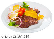 Well-done beef steak with cheese and baked potatoes at plate. Стоковое фото, фотограф Яков Филимонов / Фотобанк Лори
