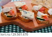 Купить «Canape with soft cheese at fresh bread with cucumber and salmon», фото № 29561670, снято 23 марта 2019 г. (c) Яков Филимонов / Фотобанк Лори