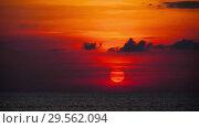 Купить «Red sunset over ocean», видеоролик № 29562094, снято 4 декабря 2018 г. (c) Игорь Жоров / Фотобанк Лори