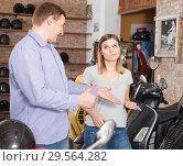 Купить «Couple is choosing new motobike and woman is surprised choice her husband», фото № 29564282, снято 8 мая 2018 г. (c) Яков Филимонов / Фотобанк Лори