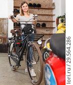 Купить «girl enjoys buying bicycle», фото № 29564286, снято 8 мая 2018 г. (c) Яков Филимонов / Фотобанк Лори