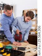 Купить «Woodworker working with pupil», фото № 29564306, снято 17 мая 2017 г. (c) Яков Филимонов / Фотобанк Лори