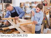 Купить «father and son repairing wood bench at garage», фото № 29564310, снято 17 мая 2017 г. (c) Яков Филимонов / Фотобанк Лори