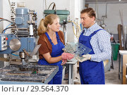 Female worker with foreman working on glass drilling machine. Стоковое фото, фотограф Яков Филимонов / Фотобанк Лори