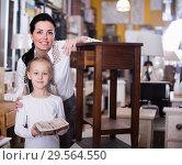 Купить «Woman with daughter standing with curbstone in store», фото № 29564550, снято 27 декабря 2017 г. (c) Яков Филимонов / Фотобанк Лори