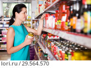 Купить «female in the shop holding preserved jar of olives», фото № 29564570, снято 6 июня 2017 г. (c) Яков Филимонов / Фотобанк Лори