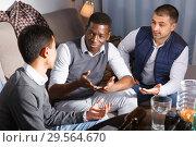 Купить «Happy males enjoying сonversation on sofa», фото № 29564670, снято 23 февраля 2018 г. (c) Яков Филимонов / Фотобанк Лори