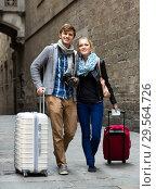 Купить «Couple of tourists», фото № 29564726, снято 14 декабря 2018 г. (c) Яков Филимонов / Фотобанк Лори