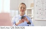 Купить «businesswoman with smartphone and smart watch», видеоролик № 29564926, снято 10 декабря 2018 г. (c) Syda Productions / Фотобанк Лори