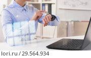 Купить «businesswoman using smart watch at office», видеоролик № 29564934, снято 10 декабря 2018 г. (c) Syda Productions / Фотобанк Лори