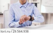 Купить «businesswoman with smartphone and smart watch», видеоролик № 29564938, снято 10 декабря 2018 г. (c) Syda Productions / Фотобанк Лори