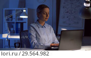 Купить «businesswoman with laptop working at night office», видеоролик № 29564982, снято 10 декабря 2018 г. (c) Syda Productions / Фотобанк Лори
