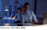 Купить «businesswoman calling on smartphone at dark office», видеоролик № 29564986, снято 10 декабря 2018 г. (c) Syda Productions / Фотобанк Лори