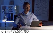 Купить «businesswoman with tablet and files at dark office», видеоролик № 29564990, снято 10 декабря 2018 г. (c) Syda Productions / Фотобанк Лори
