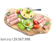 Купить «Pieces of Italian prosciutto on a wooden cutting board», фото № 29567998, снято 12 декабря 2018 г. (c) Татьяна Ляпи / Фотобанк Лори