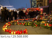 Купить «Germany, Berlin - Commemoration of the victims of the terrorist attack at Christmas Market Breitscheidplatz (Gedaechtniskirche) 2016», фото № 29568690, снято 20 декабря 2017 г. (c) Caro Photoagency / Фотобанк Лори