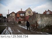 Купить «Poland, Bytom - old, run-down mining settlement in Bobrek district with industrial chimneys», фото № 29568734, снято 28 февраля 2018 г. (c) Caro Photoagency / Фотобанк Лори
