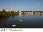 Prague, Hlavni mesto Praha, Czech Republic - Moldova and Prague Castle. City view with the Lesser Town and the castle hill. (2018 год). Редакционное фото, агентство Caro Photoagency / Фотобанк Лори