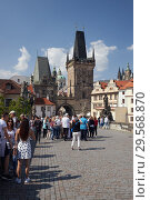 Купить «Prague, Hlavni mesto Praha, Czech Republic - On the Charles Bridge. Tourists around the Kleinseiter bridge tower.», фото № 29568870, снято 5 сентября 2018 г. (c) Caro Photoagency / Фотобанк Лори