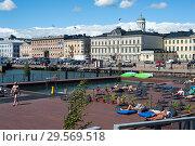 Купить «Helsinki, Finland, Guests on the sun terrace of the Allas Sea Pool », фото № 29569518, снято 23 июня 2018 г. (c) Caro Photoagency / Фотобанк Лори