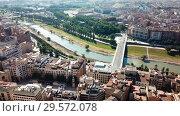 Купить «Aerial view of Lleida city with a apartment buildings and river, Spain», видеоролик № 29572078, снято 25 июля 2018 г. (c) Яков Филимонов / Фотобанк Лори