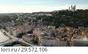 Купить «View from drone of Cathedral of Saint-Jean and Notre Dame Basilica on Fourviere hill on bank of river Saone in Lyon, France», видеоролик № 29572106, снято 24 октября 2018 г. (c) Яков Филимонов / Фотобанк Лори