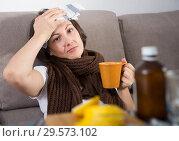 Купить «Sick woman with medicines lying on sofa», фото № 29573102, снято 22 ноября 2018 г. (c) Яков Филимонов / Фотобанк Лори