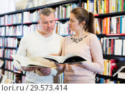 Купить «Couple choosing books in bookstore», фото № 29573414, снято 22 февраля 2018 г. (c) Яков Филимонов / Фотобанк Лори