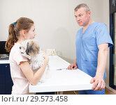 Купить «Cheerful girl with dog at veterinarian clinic», фото № 29573458, снято 3 мая 2018 г. (c) Яков Филимонов / Фотобанк Лори