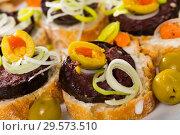 Купить «Canapes with blood sausage and olives», фото № 29573510, снято 18 июля 2019 г. (c) Яков Филимонов / Фотобанк Лори