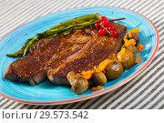 Купить «Grilled veal loin with baked vegetables», фото № 29573542, снято 29 июня 2018 г. (c) Яков Филимонов / Фотобанк Лори