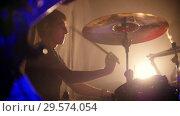 Купить «Drummer and guitarist play their parts in slow-mo on a rock band performance at the club», видеоролик № 29574054, снято 19 марта 2019 г. (c) Константин Шишкин / Фотобанк Лори