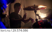 Купить «Emotional drummer on a rock band performance», видеоролик № 29574086, снято 19 марта 2019 г. (c) Константин Шишкин / Фотобанк Лори