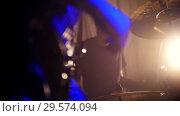 Купить «Emotional drummer on rock band performance at the club», видеоролик № 29574094, снято 16 января 2019 г. (c) Константин Шишкин / Фотобанк Лори