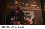 Купить «A young woman performs in a rock band at a concert», видеоролик № 29574226, снято 16 января 2019 г. (c) Константин Шишкин / Фотобанк Лори