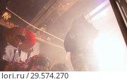 Купить «The singer leaning closer to the camera emotionally sings on concert», видеоролик № 29574270, снято 16 января 2019 г. (c) Константин Шишкин / Фотобанк Лори