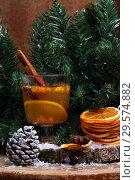 Купить «Горячий напиток из облепихи в новогоднем декоре», фото № 29574882, снято 16 декабря 2018 г. (c) Марина Володько / Фотобанк Лори